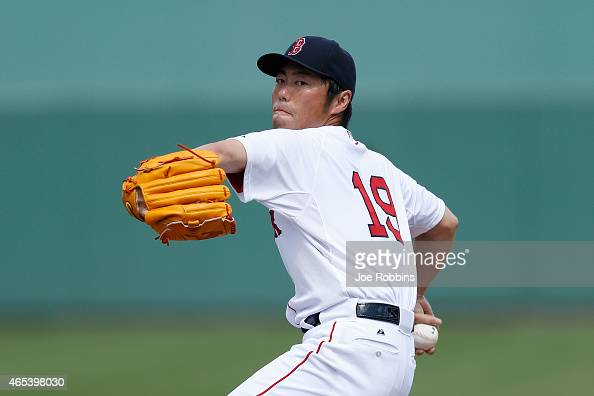 Koji Uehara of the Boston Red Sox warms up before pitching the third inning of the game against the Miami Marlins at Jet Blue Park on March 6 2015 in...