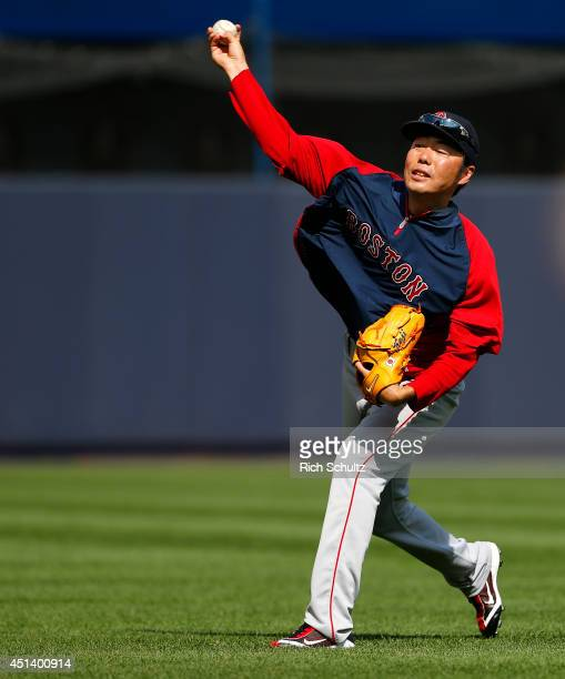 Koji Uehara of the Boston Red Sox warms up before the start of a game against the New York Yankees at Yankee Stadium on June 28 2014 in the Bronx...
