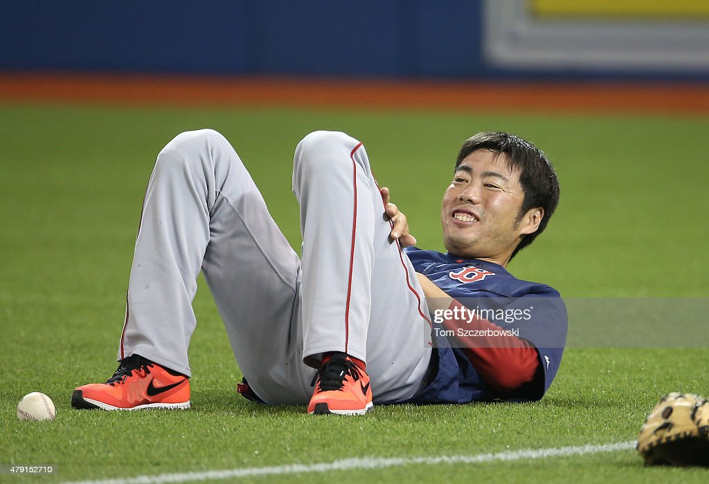Koji Uehara #19 of the Boston Red Sox warms up before the start of MLB game action against the Toronto Blue Jays on July 1, 2015 at Rogers Centre in Toronto, Ontario, Canada.