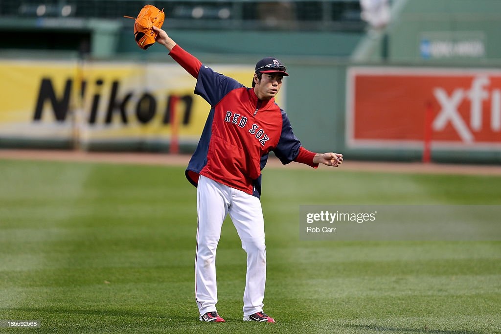Koji Uehara #19 of the Boston Red Sox warms up during team workout in the 2013 World Series Media Day at Fenway Park on October 22, 2013 in Boston, Massachusetts. The Red Sox host the Cardinals in Game 1 on October 23, 2013.