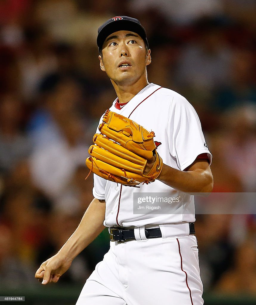 Koji Uehara #19 of the Boston Red Sox watches the flight of a foul ball against the Chicago White Sox in the ninth inning at Fenway Park on July 9, 2014 in Boston, Massachusetts.