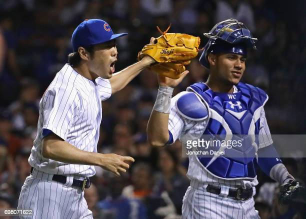 Koji Uehara of the Chicago Cubs celebrates with Willson Contreras after pitching a scoreless 8th inning against the San Diego Padres at Wrigley Field...