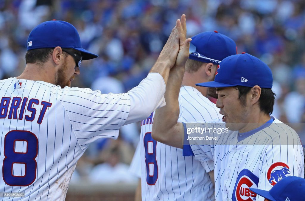 Koji Uehara #19 of the Chicago Cubs 'high fives' teammate Ben Zobirst after the 8th inning against the Pittsburgh Pirates at Wrigley Field on July 7, 2017 in Chicago, Illinois.