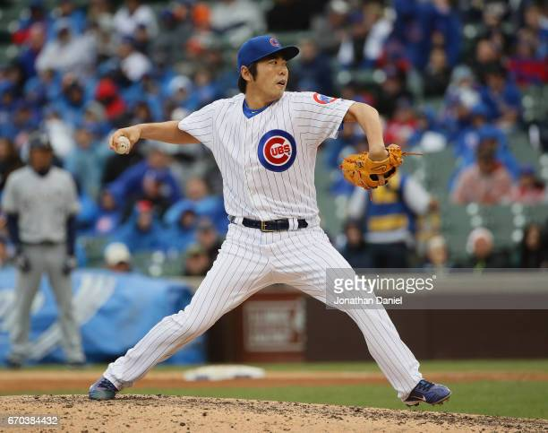 Koji Uehara of the Chicago Cubs pitches a one two three 8th inningagainst the Milwaukee Brewers at Wrigley Field on April 19 2017 in Chicago Illinois...