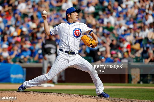 Koji Uehara of the Chicago Cubs pitches against the Colorado Rockies during the eighth inning at Wrigley Field on June 11 2017 in Chicago Illinois...