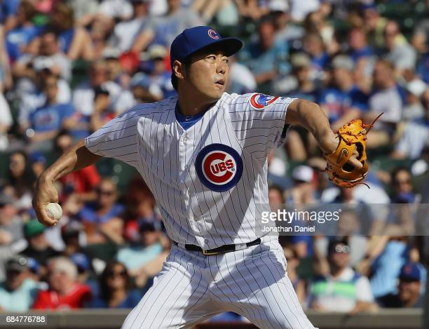 Koji Uehara of the Chicago Cubs pitches aganst the Cincinnati Reds in the 9th inning at Wrigley Field on May 18 2017 in Chicago Illinois The Cubs...