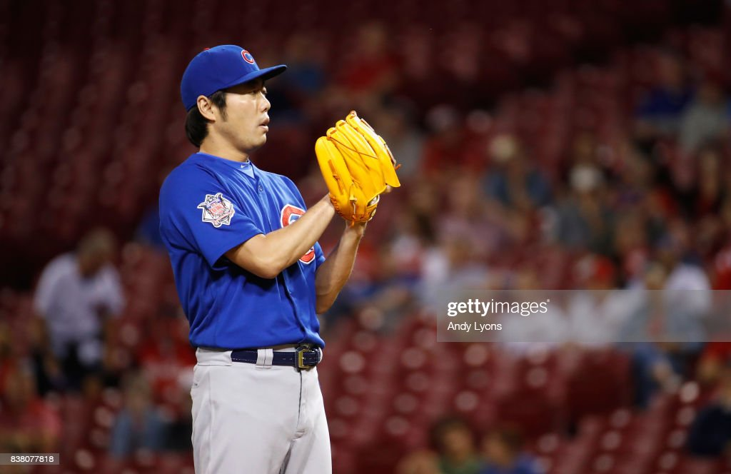 Koji Uehara #19 of the Chicago Cubs prepares to throw a pitch against the Cincinnati Reds in the 8th inning at Great American Ball Park on August 23, 2017 in Cincinnati, Ohio.