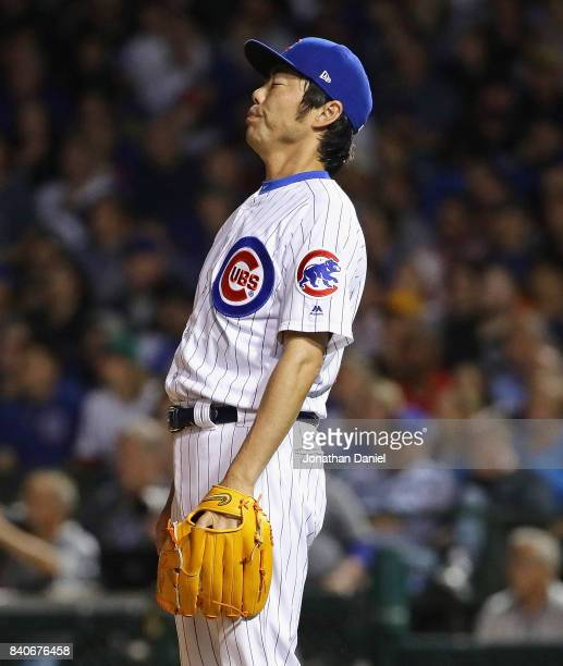 Koji Uehara of the Chicago Cubs reacts after giving up a solo home run in the 7th inning to John Jaso of the Pittsburgh Pirates at Wrigley Field on...