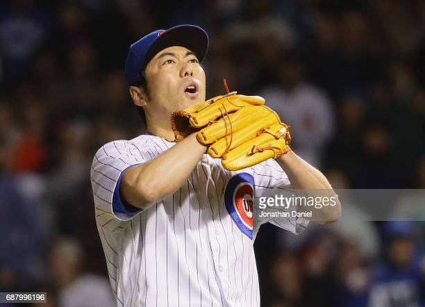 Koji Uehara of the Chicago Cubs reacts after walking the bases loaded in the 8th inning against the San Francisco Giants at Wrigley Field on May 24...