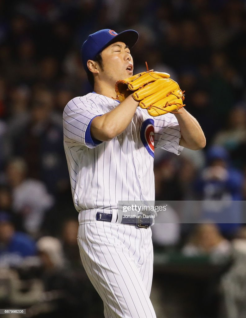 Koji Uehara #19 of the Chicago Cubs reacts after walking the bases loaded in the 8th inning against the San Francisco Giants at Wrigley Field on May 24, 2017 in Chicago, Illinois.