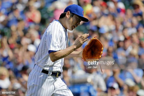Koji Uehara of the Chicago Cubs reacts at the end of the eighth inning against the Colorado Rockies at Wrigley Field on June 11 2017 in Chicago...