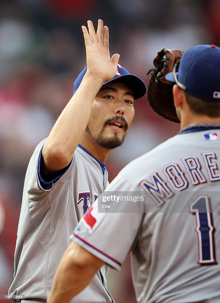 <a gi-track='captionPersonalityLinkClicked' href=/galleries/search?phrase=Koji+Uehara&family=editorial&specificpeople=801278 ng-click='$event.stopPropagation()'>Koji Uehara</a> #19 of the Texas Rangers celebrates the lastl out of the game with teammate <a gi-track='captionPersonalityLinkClicked' href=/galleries/search?phrase=Mitch+Moreland&family=editorial&specificpeople=6824046 ng-click='$event.stopPropagation()'>Mitch Moreland</a> #18 on September 4, 2011 at Fenway Park in Boston, Massachusetts.The Texas Rangers defeated the Boston Red Sox 11-4.