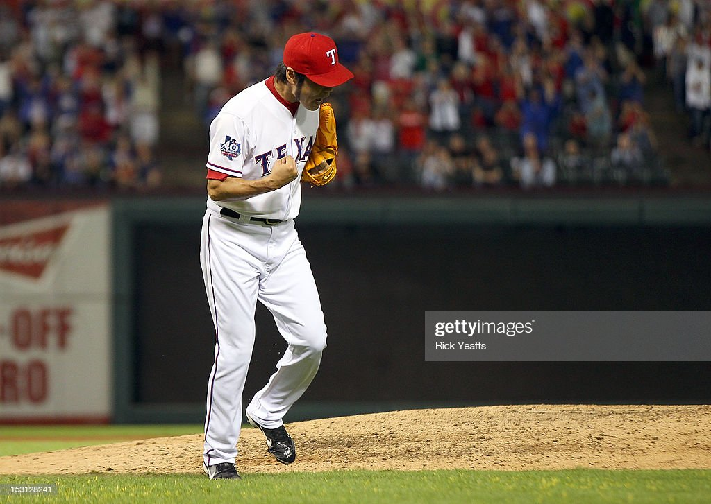 <a gi-track='captionPersonalityLinkClicked' href=/galleries/search?phrase=Koji+Uehara&family=editorial&specificpeople=801278 ng-click='$event.stopPropagation()'>Koji Uehara</a> #19 of the Texas Rangers clenches his fist in celebration of striking out three in a row in game two of the double header against the Los Angeles Angels of Anaheim at Rangers Ballpark in Arlington on September 30, 2012 in Arlington, Texas.