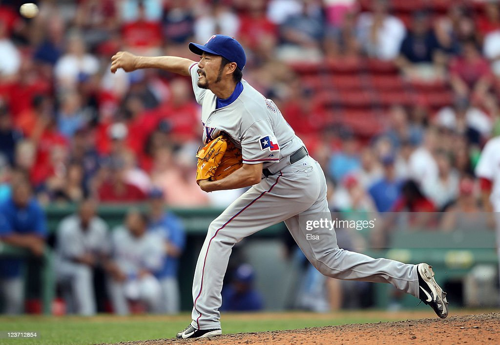 <a gi-track='captionPersonalityLinkClicked' href=/galleries/search?phrase=Koji+Uehara&family=editorial&specificpeople=801278 ng-click='$event.stopPropagation()'>Koji Uehara</a> #19 of the Texas Rangers delivers a pitch in the ninth inning against the Boston Red Sox on September 4, 2011 at Fenway Park in Boston, Massachusetts.The Texas Rangers defeated the Boston Red Sox 11-4.