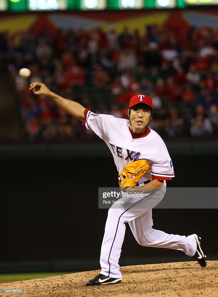 <a gi-track='captionPersonalityLinkClicked' href=/galleries/search?phrase=Koji+Uehara&family=editorial&specificpeople=801278 ng-click='$event.stopPropagation()'>Koji Uehara</a> #19 of the Texas Rangers pitches in game two of the double header against the Los Angeles Angels of Anaheim at Rangers Ballpark in Arlington on September 30, 2012 in Arlington, Texas.