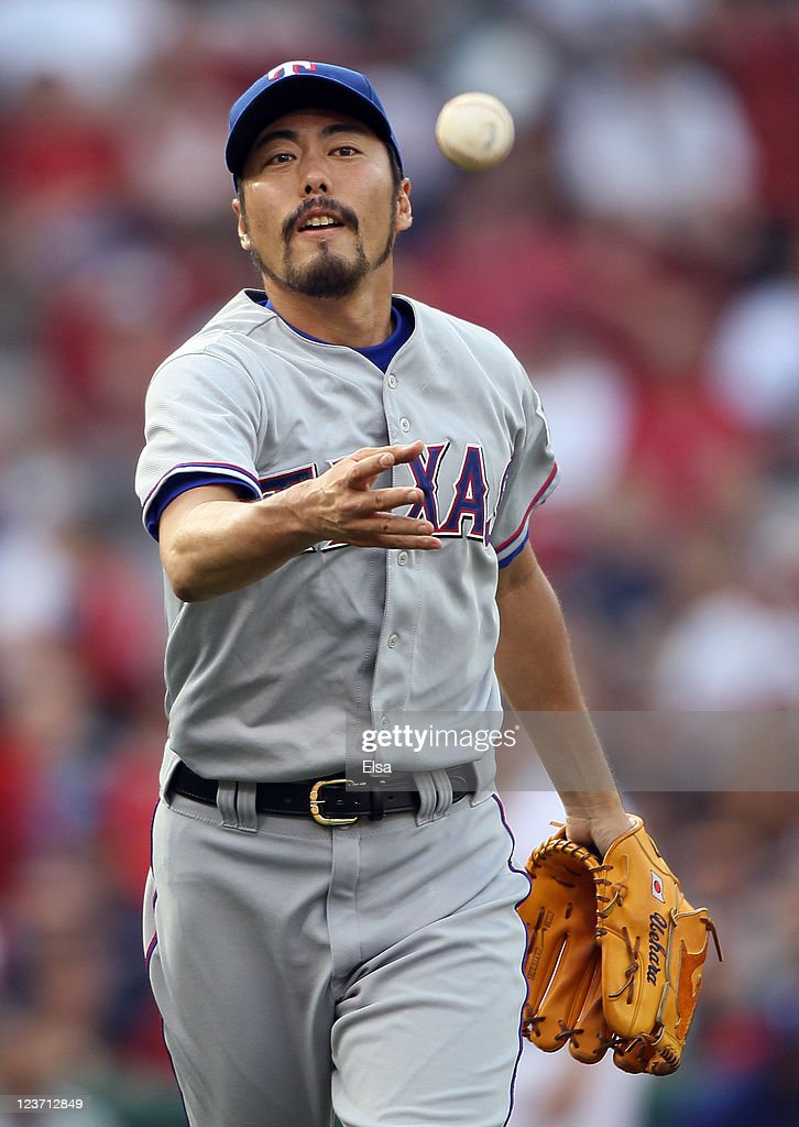 <a gi-track='captionPersonalityLinkClicked' href=/galleries/search?phrase=Koji+Uehara&family=editorial&specificpeople=801278 ng-click='$event.stopPropagation()'>Koji Uehara</a> #19 of the Texas Rangers sends the ball to first for the final out of the game against the Boston Red Sox on September 4, 2011 at Fenway Park in Boston, Massachusetts.The Texas Rangers defeated the Boston Red Sox 11-4.