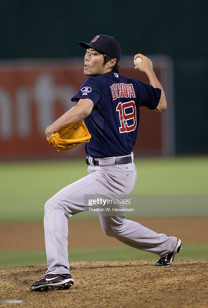 <a gi-track='captionPersonalityLinkClicked' href=/galleries/search?phrase=Koji+Uehara&family=editorial&specificpeople=801278 ng-click='$event.stopPropagation()'>Koji Uehara</a> #19 pitches in the ninth inning against the Oakland Athletics at O.co Coliseum on July 12, 2013 in Oakland, California. The Red Sox won the game 4-2.