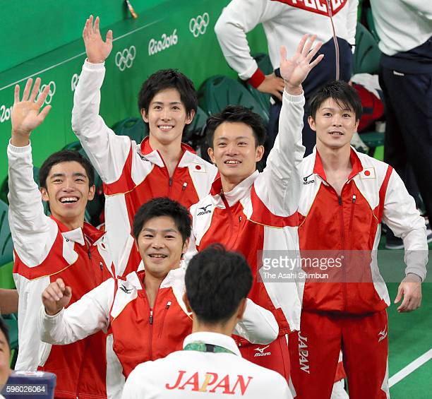 Koji Yamamuro Yusuke Tanaka Kohei Uchimura Ryohei Kato and Kenzo Shirai of Japan celebrate winning the gold medal after competing in the men's team...