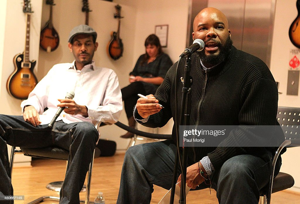 Kokayi (R) moderates a panel of brand representatives and artists to discuss the growing affiliations between bands and brands at Business, Beats and Inspiration: Bands & Brands at The Gibson Guitar Center on November 19, 2013 in Washington, DC.