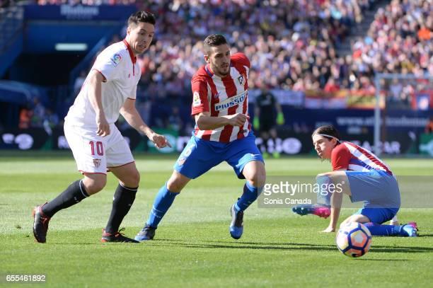 Koke #6 of Atletico de Madrid and Nasri #10 of Sevilla FC during The La Liga match between Atletico Madrid v Valencia FC at Vicente Calderon on March...