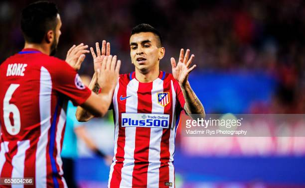 Koke acknowledges his team mate Angel Correa of Atleticko during the UEFA Champions League Round of 16 second leg match between Atletico Madrid and...