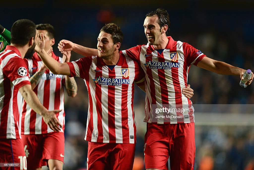 Koke and Diego Godin (R) of Club Atletico de Madrid celebrate victory after the UEFA Champions League semi-final second leg match between Chelsea and Club Atletico de Madrid at Stamford Bridge on April 30, 2014 in London, England.