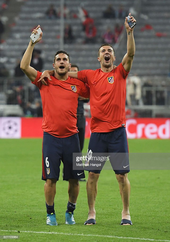Koke (L) and Gabi of Atletico Madrid celebrate after the UEFA Champions League semi final second leg match between FC Bayern Muenchen and Club Atletico de Madrid at Allianz Arena on May 3, 2016 in Munich, Germany. Bayern Munich won the match 2-1, but Atletico Madrid reached the final on the away goals rule.