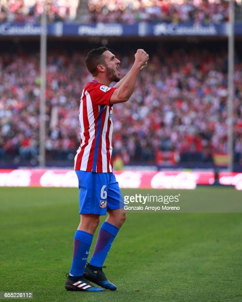 Koke of Atletico de Madrid celebrates scoring their third goal during the La Liga match between Club Atletico de Madrid and Sevilla FC at Vicente...
