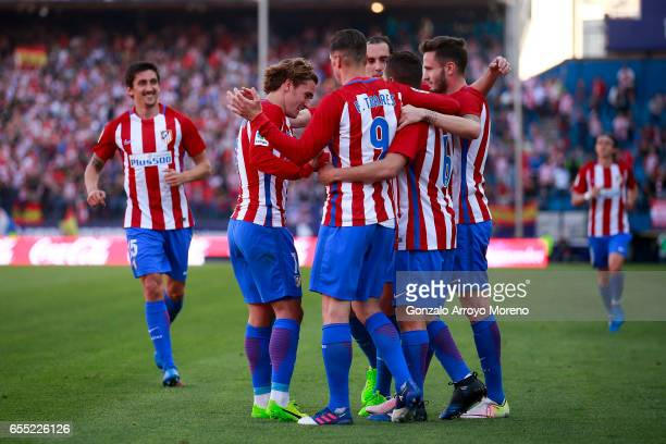 Koke of Atletico de Madrid celebrates scoring their third goal with teammates Saul Niguez Diego Godin Fernando Torres Antoine Griezmann and Stefan...