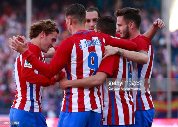 Koke of Atletico de Madrid celebrates scoring their third goal with teammates Saul Niguez Diego Godin Fernando Torres and Antoine Griezmann during...
