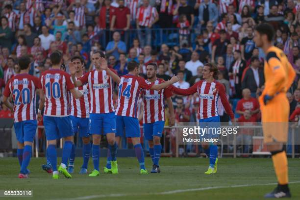 Koke of Atletico de Madrid celebrates with teammates after scoring the third goal of his team during the La Liga match between Club Atletico de...