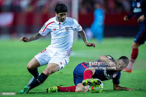 Koke of Atletico de Madrid competes for the ball with Ever Banega of Sevilla FC during the La Liga match between Sevilla FC and Club Atletico de...