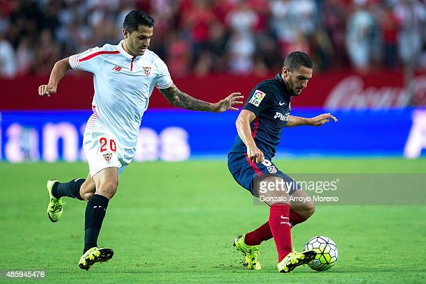 Koke of Atletico de Madrid competes for the ball with Vctor Machin alias Vitolo of Sevilla FC during the La Liga match between Sevilla FC and Club...