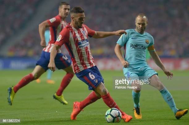 Koke of Atletico de Madrid fight the ball with Andres Iniesta of Barcelona during a match between Atletico Madrid and Barcelona as part of La Liga at...