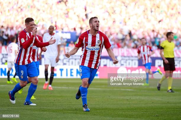 Koke of Atletico de Madridy celebrates scoring their third goal with teammate Fernando Torres during the La Liga match between Club Atletico de...