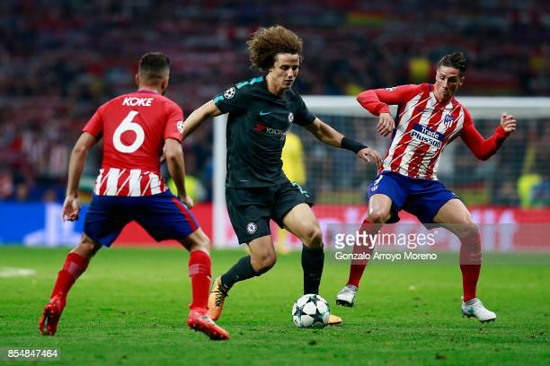 Koke of Atletico Madrid and Fernando Torres of Atletico Madrid close down David Luiz of Chelsea during the UEFA Champions League group C match...