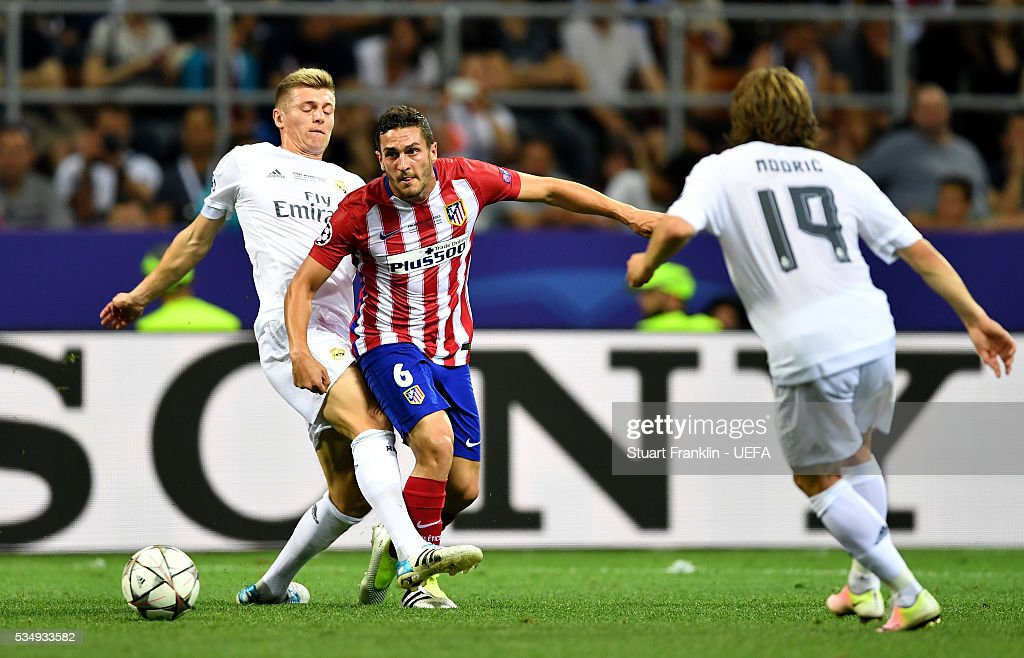 Koke of Atletico Madrid and Toni Kroos of Real Madrid compete for the ball during the UEFA Champions League Final between Real Madrid and Club Atletico de Madrid at Stadio Giuseppe Meazza on May 28, 2016 in Milan, Italy..