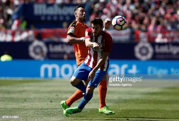 Koke of Atletico Madrid in action against Sergi Enrich of Eibar during the La Liga football match between Atletico Madrid and Eibar at Vicente...