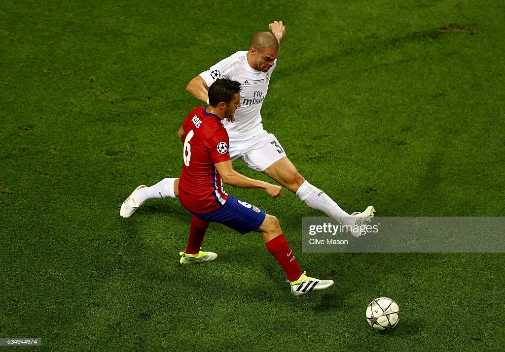 <a gi-track='captionPersonalityLinkClicked' href=/galleries/search?phrase=Koke+-+Midfielder+born+1992&family=editorial&specificpeople=11132098 ng-click='$event.stopPropagation()'>Koke</a> of Atletico Madrid is challenged by <a gi-track='captionPersonalityLinkClicked' href=/galleries/search?phrase=Pepe+-+Portuguese+Soccer+Player&family=editorial&specificpeople=4401229 ng-click='$event.stopPropagation()'>Pepe</a> of Real Madrid during the UEFA Champions League Final match between Real Madrid and Club Atletico de Madrid at Stadio Giuseppe Meazza on May 28, 2016 in Milan, Italy.