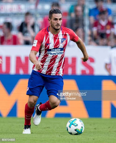 Koke of Atletico Madrid runs with the ball during the Audi Cup 2017 match between Club Atletico de Madrid and SSC Napoli at Allianz Arena on August 1...