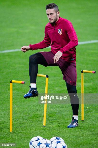 Koke of Atletico warms up during the training prior the UEFA Champions League Round of 16 first leg match between Bayer Leverkusen and Club Atletico...