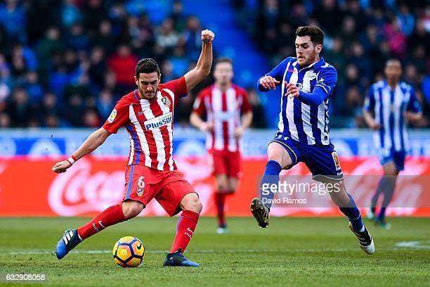 Koke Resurreccion of Club Atletico de Madrid competes for the ball with Ibai Gomez of Deportivo Alaves during the La Liga match between Deportivo...