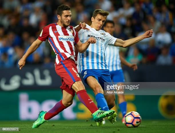 Koke Resurreccion of Club Atletico de Madrid shoots for score the first goal for Club Atletico de Madrid while isbeing followed by Diego Llorente of...