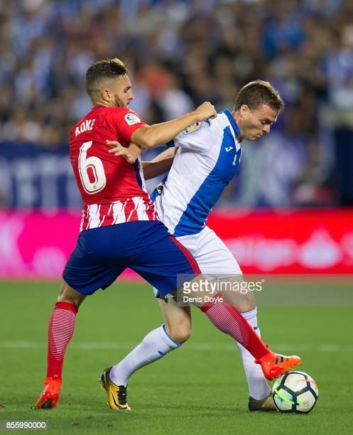 Koke Resurreccion of Club Atletico de Madrid tackles Javier Eraso of CD Leganes during the La Liga match between Leganes and Atletico Madrid at...
