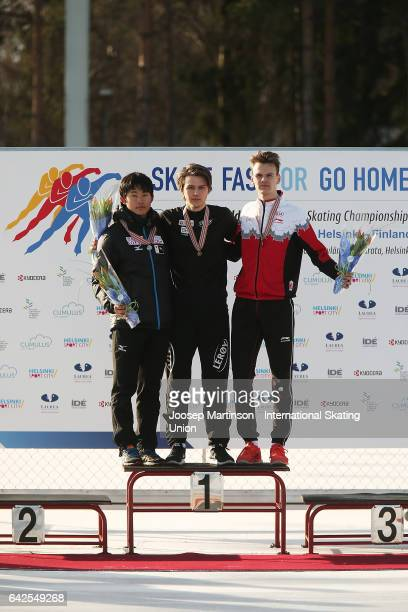 Koki Kubo of Japan Allan Dahl Johansson of Norway and Tyson Langelaar of Canada pose in the men's 1000m medal ceremony during day two of the World...