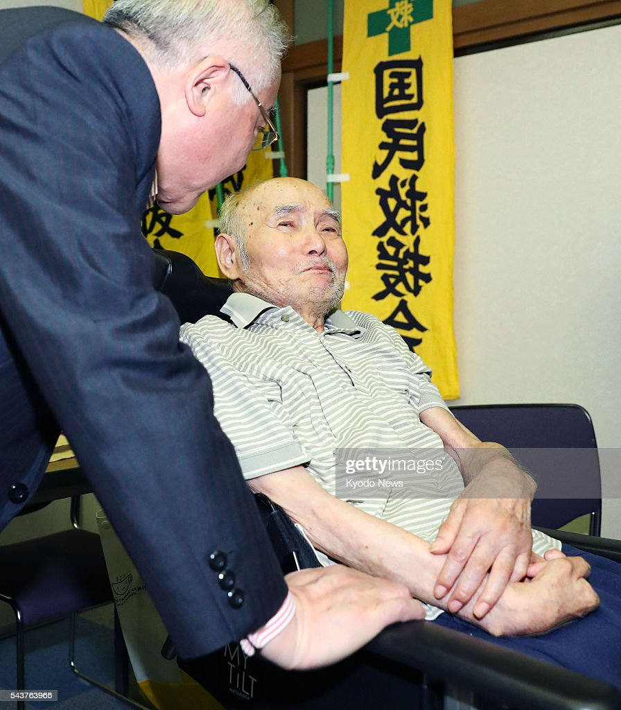Koki Miyata, who served a 13-year prison term, attends a press conference in a wheelchair in the southwestern Japan city of Kumamoto on June 30, 2016, after the Kumamoto District Court decided to retry the 83-year-old, who confessed he killed a 59-year-old acquaintance in 1985. The court said 'doubts have been raised' over the credibility of his initial confessions, pointing to 'contradictions' found between what he said and evidence presented by Miyata's defense team.