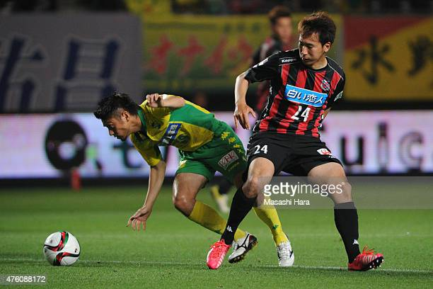 Koki Mizuno of JEF United Chiba and Akito Fukumori of Consadole Sapporo compete for the ball during the JLeague second division match between JEF...