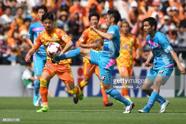 Koki Mizuno of Sagan Tosu and Ryohei Shirasaki of Shimizu SPulse compete for the ball during the JLeague J1 match between Shimizu SPulse and Sagan...