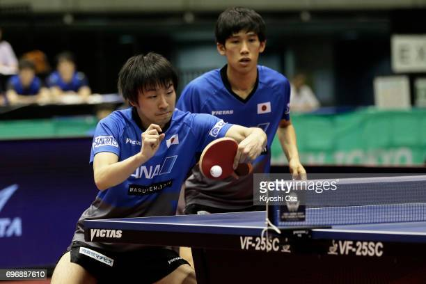 Koki Niwa and Maharu Yoshimura of Japan compete in the Men's Doubles final match against Ma Long and Xu Xin of China during day four of the 2017 ITTF...