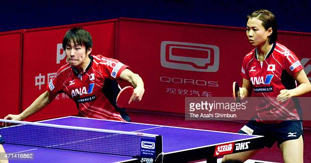 Koki Niwa and Sayaka Hirano of Japan compete in the Mixed Doubles Third Round match on day three of the 2015 World Table Tennis Championships on...